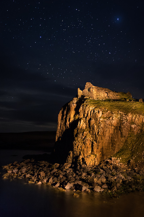 SCOTLAND - CIRCA APRIL 2016: Duntulm Castle at night. The castle stands ruined on the north coast of Trotternish, on the Isle of Skye in Scotland, near the hamlet of Duntulm.