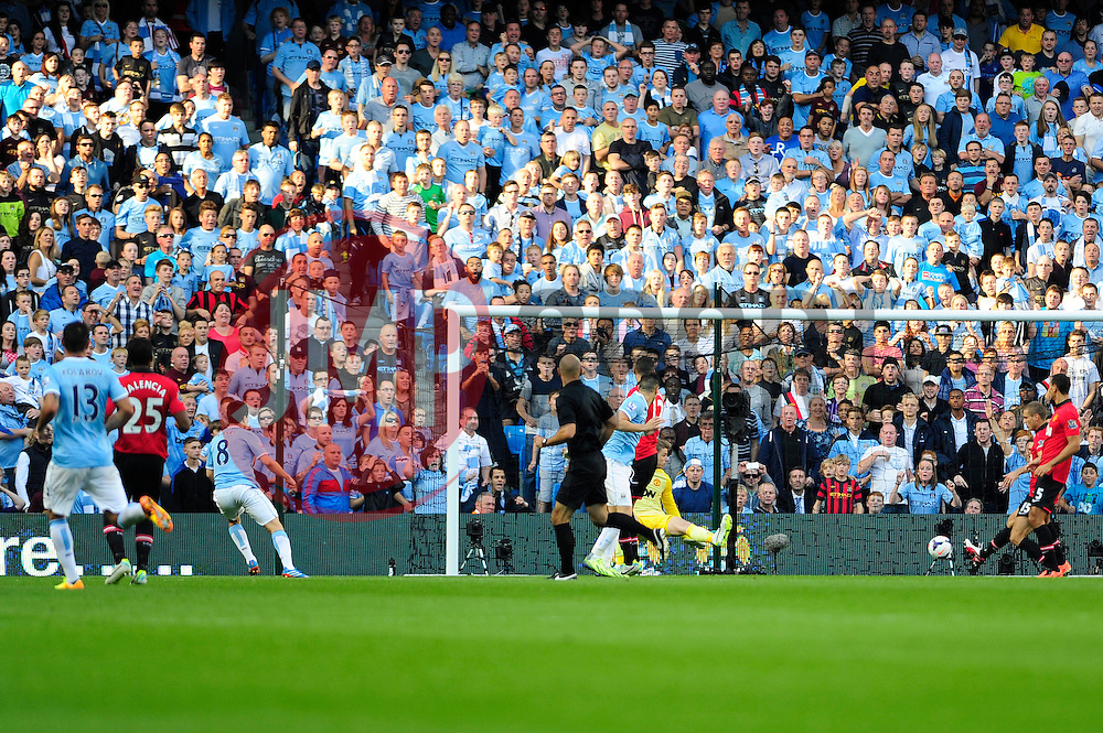 Manchester City's Samir Nasri scores a goal. - Photo mandatory by-line: Dougie Allward/JMP - Tel: Mobile: 07966 386802 22/09/2013 - SPORT - FOOTBALL - City of Manchester Stadium - Manchester - Manchester City V Manchester United - Barclays Premier League