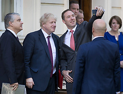 © Licensed to London News Pictures. 14/05/2018. London, UK.  British Foreign Secretary Boris Johnson (2L) poses for a selfie with members of the Panamanian delegation during a visit of President Juan Carlos Varela of Panama to London. Photo credit: Peter Macdiarmid/LNP