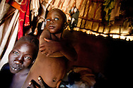 A mother and her child in Jonglei state, Southern Sudan. The Jie tribe has had dozens of children abducted by the neighboring Murle tribe in the last 15 years increasing the insecurity in the region.