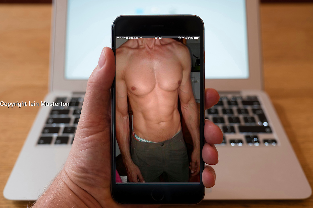 Using iPhone smartphone to display profile photograph on Grindr the gay dating app