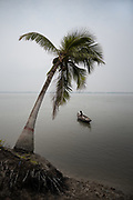 Fisherman from the eroded village of Kaliburi, southwestern Bangladesh. The slow nibbling of land by rivers is a not spectacular drama that deprives peasants of their land and families of their habitat. The rising tide levels and the intensification of storms due to global warming are accelerating this phenomenon of erosion.