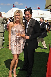 TINA HOBLEY and OLIVER WHEELER at the 27th annual Cartier International Polo Day featuring the 100th Coronation Cup between England and Brazil held at Guards Polo Club, Windsor Great Park, Berkshire on 24th July 2011.