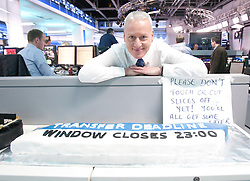 Jim White at the Sky Sports TV studio for the transfer Deadline Day show. Pic with Deadline cake..© Michael Schofield...