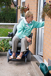 Woman wheelchair user leaving her house,