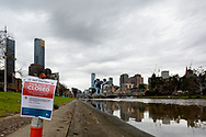 A view of the boat ramp on the Yarra River where a sign prohibiting all recreational boating is seen with the city in the background during COVID-19 in Melbourne, Australia. Victoria has recorded 14 COVID related deaths including a 20 year old, marking the youngest to die from Coronavirus in Australia, and an additional 372 new cases overnight. (Photo by Dave Hewison/Speed Media)