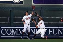 August 8, 2017 - Minneapolis, MN, USA - Minnesota Twins left fielder Eddie Rosario, left, gloves a pop fly hit by the Milwaukee Brewers' Ryan Braun, with help from center fielder Byron Buxton, right, in the first inning at Target Field in Minneapolis on Tuesday, Aug. 8, 2017. (Credit Image: © Anthony Souffle/TNS via ZUMA Wire)