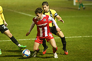 Harrogates Josh Falkingham and Exeters Ben Seymour compete for the ball during the EFL Sky Bet League 2 match between Harrogate Town and Exeter City at the EnviroVent Stadium, Harrogate, United Kingdom on 19 January 2021.