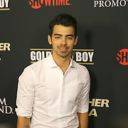 Joe Jonas is seen on the red carpet prior to the Mayweather versus Maidana boxing match at the MGM Grand hotel on Saturday, May 3, 2014 in Las Vegas, Nevada.  (AP Photo/Alex Menendez)
