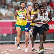 TOKYO, JAPAN August 3:   Morgan McDonald of Australia and Jamal Abdelmaji Eisa Mohammod of the Refugee Olympic Team in action during the Men's 5000m round one heat two race at the Olympic Stadium during the Tokyo 2020 Summer Olympic Games on August 3rd, 2021 in Tokyo, Japan. (Photo by Tim Clayton/Corbis via Getty Images)