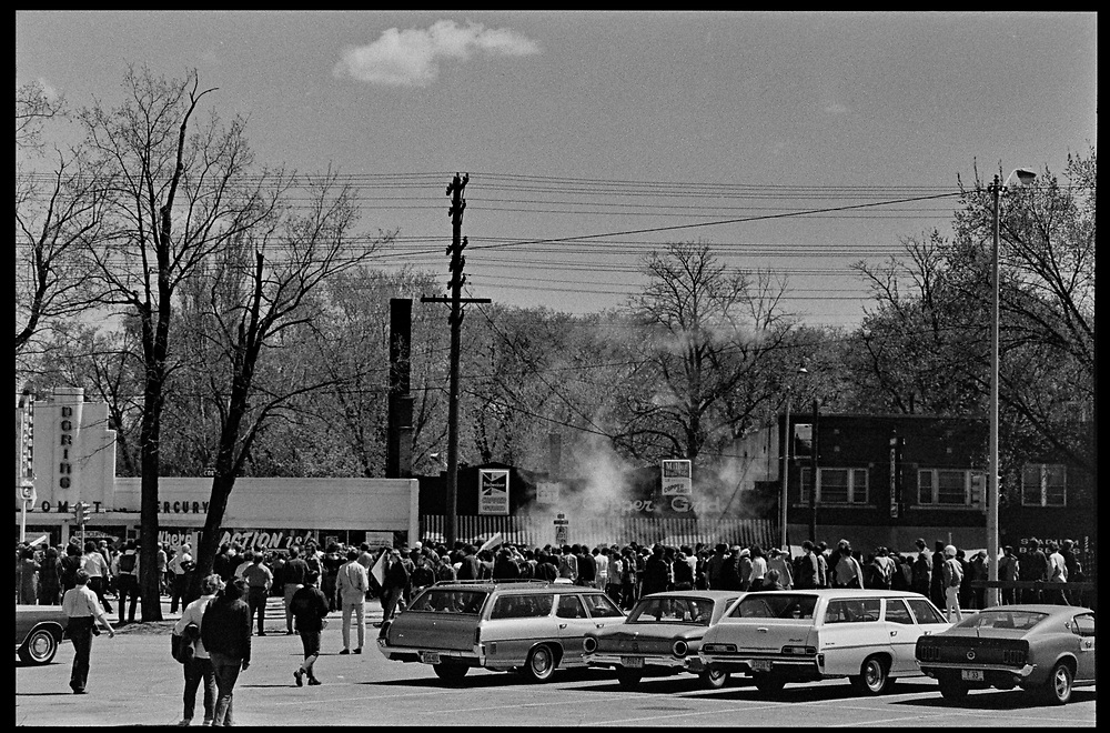 Madison, WI – May, 1970. On May 1, 1970, there was a general student strike in response to the news that the U.S. had expanded bombing into Cambodia. There was a march against the war, led by Veterans for Peace in Vietnam; and after the May 4 shootings at Kent State University in Ohio, there were more protests at UW Madison, which led to the police being called in, and teargassing demonstrators in the streets and on campus. Teargas in front of the Copper Grid bar, at Regent and Monroe Streets.