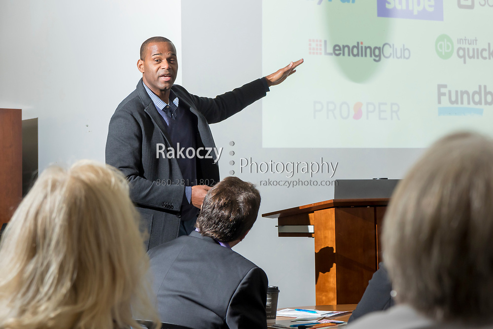 Anthony Price of LootScout speaks at a networking event hosted by Transfer Enterprises of Manchester, CT.