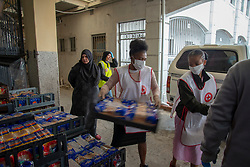"""Inside the Masjidus Sabr mosque that has become headquarters for a joint, interfaith, Parkwood Covid-19 feeding response team. Volunteers today delivered bread to the community of Parkwood, a subburb of Cape Town, located on the Cape Flats, Monday, April 20, 2020. The majority of the people who live here are unemployed during """"normal"""" circumstances. And as South Africa is now in lockdown due to the Coronavirus, many of those who had jobs have also lost their income. So many people are starving. The feeding scheme is a joint community effort, paid for solely by donations from the public to feed more than 3,000 households. The group is also receiving transportation support by The South African Red Cross Society. PHOTO: EVA-LOTTA JANSSON"""