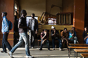 NAIROBI, KENYA - NOVEMBER 17, 2011: Youth from various tribes arrive to watch an Olympic Qualifying boxing bout. <br /> <br /> Within Kenya's progressive youth culture is the Kibera Olympic Boxing Club, a group of low-income adolescents from the slum whose leader uses boxing as a way to engage with idle youth. The group's ethnic diversity is remarkable given Kenya's 2008 post-election violence in which people from several tribes were forced violently out of slums. Together, these boxers represent a nascent trend of cross-tribe brotherhood in a healing nation.