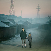 Evening air pollutiuon, mostly due to coal-fired stoves, in Bayankhoshuu, one of the worst polluted neighborhood of Ulan Bator.<br /> Mongolia