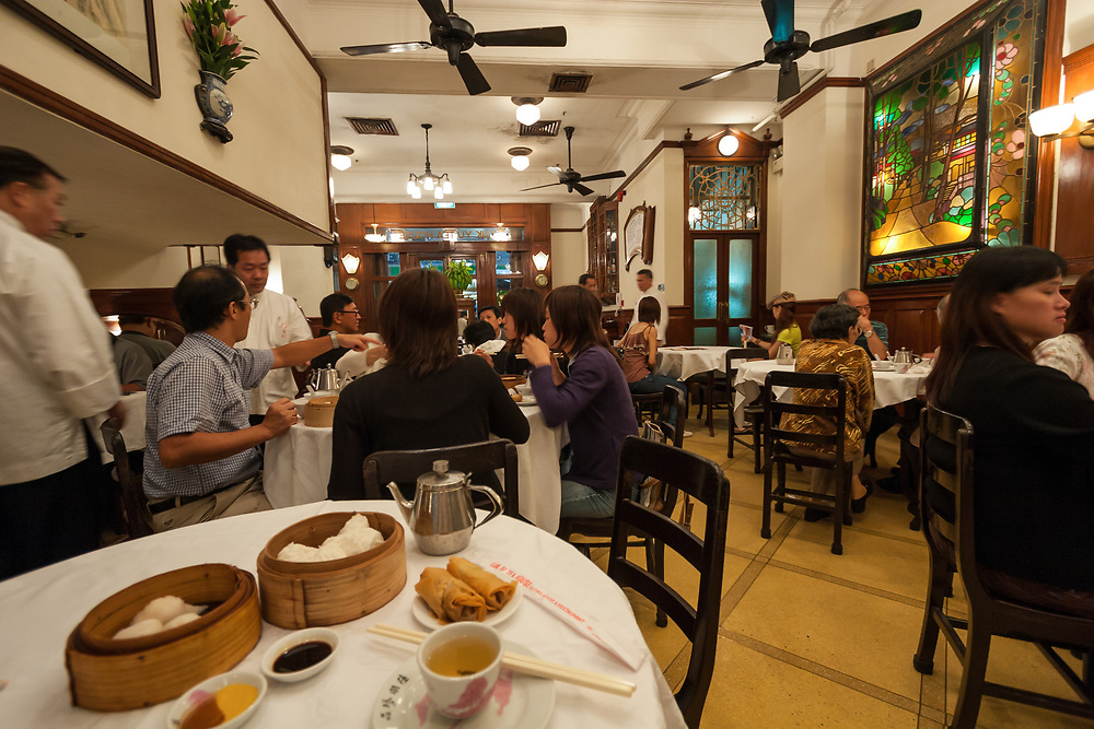Luk Yua Tea House in Hong Kong. An authentic vestige of a lost era, Luk Yu is the most famous traditional teahouse remaining in the city operating since 1933.
