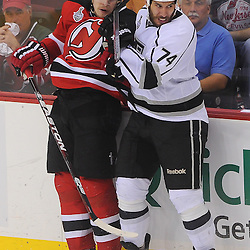 May 30, 2012: New Jersey Devils defenseman Anton Volchenkov (28) and Los Angeles Kings left wing Dwight King (74) collide along the boards during overtime action in game 1 of the NHL Stanley Cup Final between the New Jersey Devils and the Los Angeles Kings at the Prudential Center in Newark, N.J.