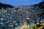 """Rocinha, Latin America's largest urban favela and one of Rio's 700 with a pop. of approx. 200.000 residents . Its currently in the middle of a drug """"war"""" between two rival drug factions."""