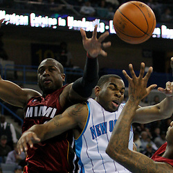 Dec 30, 2009; New Orleans, LA, USA;  New Orleans Hornets guard Marcus Thornton (5) battles for a rebound with Miami Heat guard Dwyane Wade (left) and forward Dorell Wright (right) at the New Orleans Arena. The Hornets defeated the Heat 95-91.  Mandatory Credit: Derick E. Hingle-US PRESSWIRE