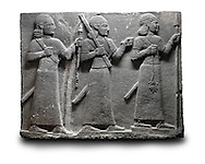 Picture & image of a Neo-Hittite orthostat of 3 warriors from the legend of Gilgamesh from Karkamis,, Turkey. Ancora Archaeological Museum. The warrior on the far left holds a spear in one hand and the branch of a tree in the other. The middle warrior has a clenched fist an carries an impliment over his shoulder. The warrior on the far right carries a saff. All 3 are wearing swords.