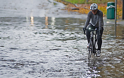 © Licensed to London News Pictures. 15/11/2020.  <br /> Aylesford, UK. A cyclist riding through flood water. Severe flooding to roads in Aylesford near Maidstone in Kent. Over one hundred flood alerts are put in place by the Met Office today as the UK is hit with heavy overnight rain and gale force winds. Photo credit:Grant Falvey/LNP