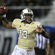 ORLANDO, FL - OCTOBER 09:  Quarterback Justin Holman #13 of the UCF Knights passes the football against the BYU Cougars at Bright House Networks Stadium on October 9, 2014 in Orlando, Florida. (Photo by Alex Menendez/Getty Images) *** Local Caption ***Justin Holman