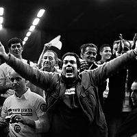 A Benjamin Netanyahu's supporter applauds enthusiasimly as Netanyahu enters the conference hall in Tel Aviv, December 2008.
