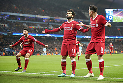 Liverpool's Mohamed Salah celebrates scoring his side's first goal of the game during the UEFA Champions League, Quarter Final at the Etihad Stadium, Manchester.