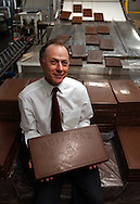 Gary Guittard, the president and owner of the Guittard Chocolate Company founded in 1868, sits with 10 pound bars of chocolate at his chocolate factory in Burlingame, Calif. on Thursday Jan. 31, 2002. Guittard has been running the company since 1988 and is the fourth generation of Guittards to do so. (Photo by Jakub Mosur)