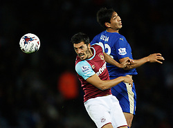 James Tomkins of West Ham United (L) and Leonardo Ulloa of Leicester City in action  - Mandatory byline: Jack Phillips/JMP - 07966386802 - 22/09/2015 - SPORT - FOOTBALL - Leicester - King Power Stadium - Leicester City v West Ham United - Capital One Cup Round 3