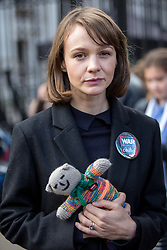 © Licensed to London News Pictures. 22/10/2016. London, UK. Carey Mulligan poses for a portrait outside Downing Street after taking part in the 'Rally For Aleppo', calling for the government to do more to stop the bombing in Syria. Photo credit : Tom Nicholson/LNP