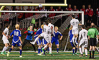 Gilford's goalie Ethan Warren makes a save against Hopkinton during NHIAA semi final Division III Soccer Wednesday evening played at the LHS turf field.  (Karen Bobotas/for the Laconia Daily Sun)
