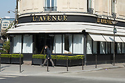 """March, 27th 2020 - Paris, Ile-de-France, France: Paris under confinement, l'Avenue, Avenue Montaigne area of high fashion, beauty, accessories, haute couture, all shops closed, in 8th arrondissement, and all public spaces virtually empty to stop the spread of the Coronavirus, during the eleventh day of near total lockdown imposed in France. The President of France, Emmanuel Macron, said the citizens must stay at home for at least 15 days, that has been extended. He said """"We are at war, a public health war, certainly but we are at war, against an invisible and elusive enemy"""". All journeys outside the home unless justified for essential professional or health reasons are outlawed. Anyone flouting the new regulations is fined. Nigel Dickinson"""