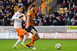 Wolves Defender Stephen Ward (IRL) makes a defensive slip as Blackpool Midfielder Thomas Ince (ENG) challenges going in to tap in the equaliser during the first half of the match - Photo mandatory by-line: Rogan Thomson/JMP - Tel: Mobile: 07966 386802 26/01/2013 - SPORT - FOOTBALL - Molineux Stadium - Wolverhampton. Wolverhampton Wonderers v Blackpool - npower Championship.