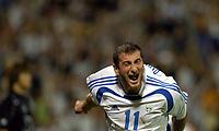 "11/08/04 - THESSALONIKI - GREECE -  -  FOOTBALL OLYMPIC MENS  -  First round Groupe A - <br />GREECE (2) V.s KOREA (2) at  THESSALONIKI ""KAFTATZOGLIO STADIUM"" <br />GREECE N*11 PAPADOPOULOS DIMITRIOS celebrating his goal . The second and draf for Greece.<br />© Gabriel Piko / Piko-Press"