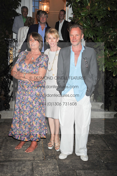 Left to right, LADY ANNABEL GOLDSMITH, TRUDIE STYLER and STING at a Summer party hosted by Lady Annabel Goldsmith at her home Ormeley Lodge, Ham, Surrey on 14th July 2009.