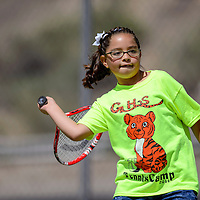 061814       Cable Hoover<br /> <br /> Lilianna Gonzales takes aim during the Gallup Bengals tennis camp at Ford Canyon Park in Gallup Wednesday.
