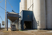 A truck pulls into the Ganner Co-op elevator in Banner Oklahoma and is loaded with wheat for shipment to market.