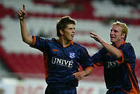 LISBOA 21 OCTOBER  2004:(L to R) HUNTELAAR #15 and HANSSON #3 celebrating together the goal in the, 1¼ leg from group G of the UEFA Cup, season 2004/2005, match SL Benfica v SC Heerenveen, held in Luz stadium, 21/10/2004  21:15<br />(PHOTO BY: NUNO ALEGRIA / AFCD)