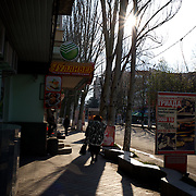 Locals pass by near the local government building in Slavyansk, days after the city was taken under control by a pro-Russia militia.