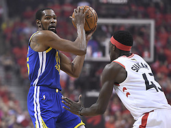 June 10, 2019 - Toronto, on, Canada - Golden State Warriors forward Kevin Durant (35) protects the ball from Toronto Raptors forward Pascal Siakam (43) during first half basketball action in Game 5 of the NBA Finals in Toronto on Monday, June 10, 2019. (Credit Image: © Frank Gunn/The Canadian Press via ZUMA Press)