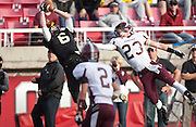 Lone Peak wide receiver Talon Shumway (6) makes a leaping catch during the Utah State High School 5A Football semifinal between Lone Peak and Jordan in Rice-Eccles Stadium, Thursday, Nov. 8, 2012.