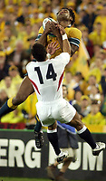 Photo. Steve Holland. England v Australia Final at the Telstra Stadium, Sydney. RWC 2003.<br />22/11/2003.<br />Lote Tuqiri catches the ball to score the first try as he is tackled by Jason Robinson