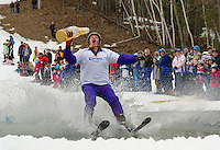 Evan Derby appeared to need a little extra refreshment as he made his way across the pond during Gunstock's Bring Your Own Dry Clothes event on Sunday afternoon.  (Karen Bobotas/for the Laconia Daily Sun)
