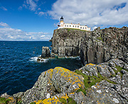 1909 Neist Point Lighthouse, on Isle of Skye, Scotland, United Kingdom, Europe. An aerial cableway takes supplies to the lighthouse and cottages. Since 1990, the lighthouse has been operated remotely from the Northern Lighthouse Board headquarters in Edinburgh. The former keepers' cottages are now in private ownership. Neist Point projects into The Minch strait and provides a nice walk and viewpoint. This image was stitched from several overlapping photos.