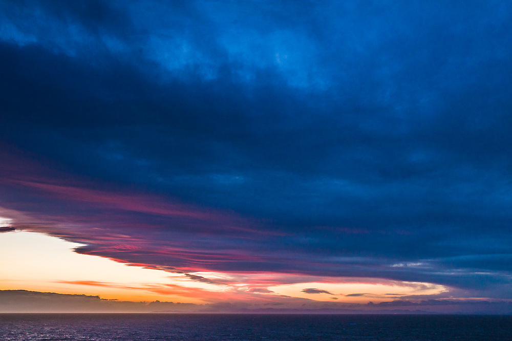 Lenticular clouds over the Strait of Juan de Fuca (Salish Sea), sunset, April, view from the Dungeness Recreation Area, Clallam County, North Olympic Peninsula, Washington, USA