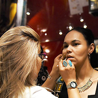 Photo N2b — Gallup hair and makeup artists, Goldie Tom, left, working backstage at the International Indigenous Fashion Show, March 1st at the Eiffel Tower in Paris, France.