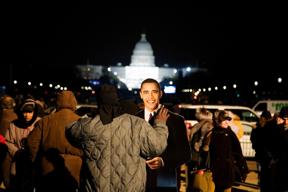 Obama Inauguration - Monday activities around the Capitol on Martin Luther King Jr. Day. Crowds wander around the Mall at nightfall on the eve of Obama's inauguration. A stand-up cardboard cut-out of Barack Obama on the National Mall looking toward the Capitol building.