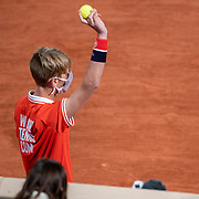 PARIS, FRANCE September 27. A ball boy during the  Jannik Sinner of Italy match against David Goffin of Belgium on Court Philippe-Chatrier in the first round of the singles competition during the  French Open Tennis Tournament at Roland Garros on September 27th 2020 in Paris, France. (Photo by Tim Clayton/Corbis via Getty Images)