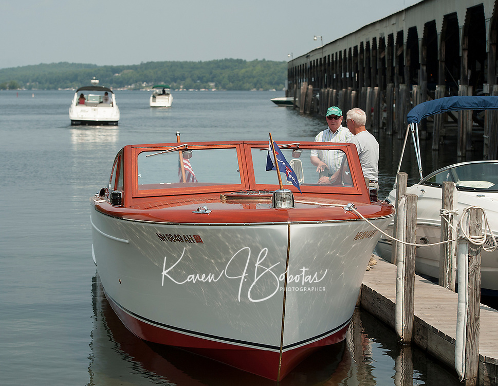 Gary Kiedaisch with Alan Lydiard at Irwin Marine as they launch Keidaisch's fully restored 1952 27' Chris Craft Cruiser at Paugus Bay, Lake Winnipesaukee. ©2014 Karen Bobotas Photographer